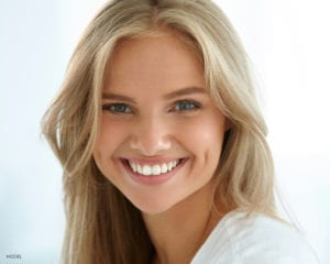 Smiling Young Blond Female with Large Teeth
